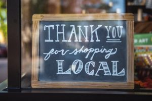 "A sign that reads, ""Thank you for shopping local."""