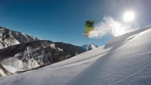 A snowboarder on a snowy mountainside