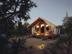 The front exterior of a desert-style glamping tent