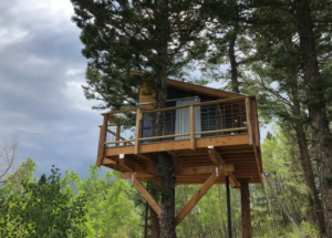 A unique elevated treehouse in the Colorado forest