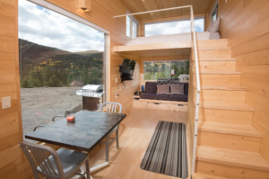 The kitchen and dining area of a tiny home that is one of the most unique places to stay in Colorado