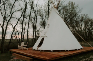 A teepee on an elevated deck, one of many unique places to stay in Colorado
