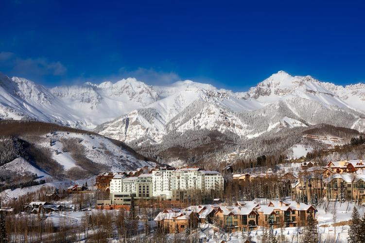 The village of Telluride in front of the San Juan mountain range, home to many 14ers in Colorado