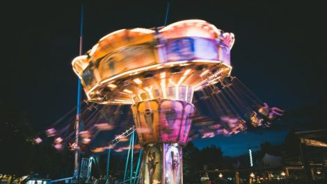 A ride lit up and spinning in Elitch Gardens, one of the bigger theme parks in Colorado